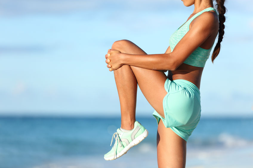 woman stretching knee