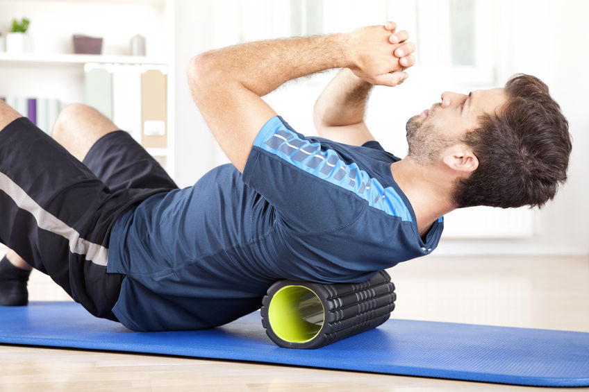 man using foam roller