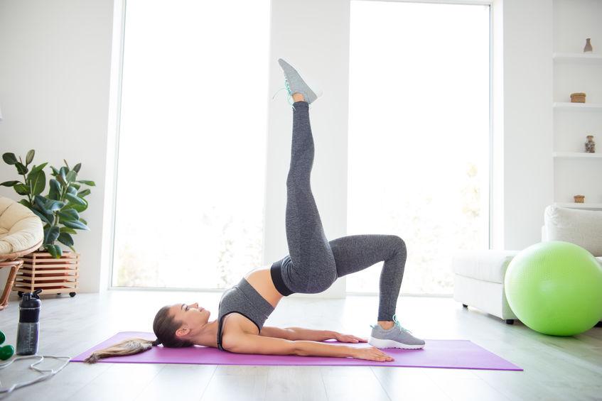 female doing glute exercises