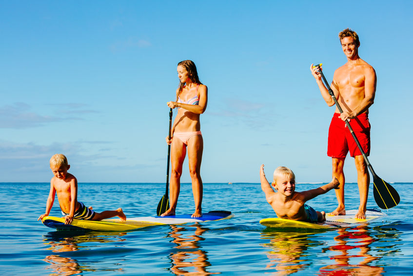 Fit family paddleboarding